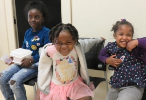 smiling kids attending Health & Wellness Day at Jane St. Hub